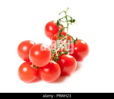 twig of tomatoes isolated on white background - Stock Photo