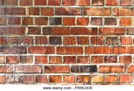 Old red brick wall texture with sunlight - Stock Photo