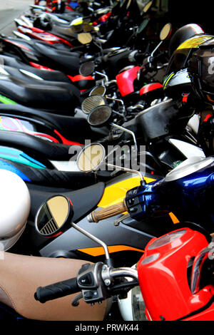 Line of colorful parking motorcycles in the city centre of Bangkok (Krung Thep), Thailand, Asia. - Stock Photo