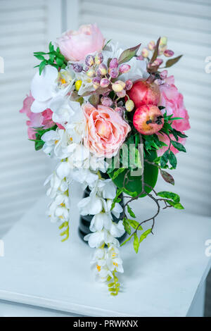 Still life with Bouquet of summer flowers in basket - Stock Photo