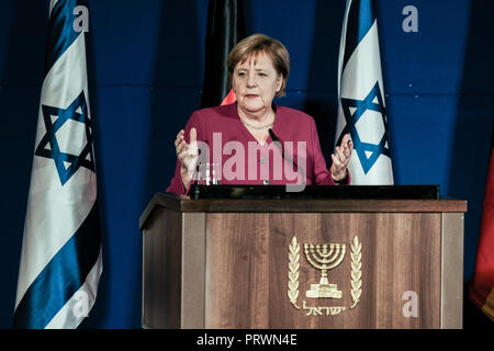 Jerusalem, Israel. 4th October, 2018. Chancellor ANGELA MERKEL of the Federal Republic of Germany and Israeli Prime Minister Netanyahu deliver statements at a joint press conference ahead of a meeting of the two governments at Jerusalem's King David Hotel. Merkel is on a 24 hour visit in Israel with a delegation of ministers. - Stock Photo