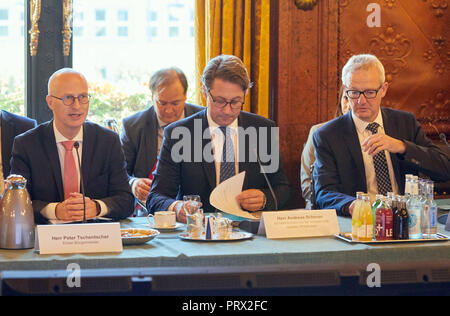 05 October 2018, Hamburg: Peter Tschentscher, Hamburg's First Mayor (SPD, l-r), Andreas Scheuer, Federal Minister of Transport and Digital Infrastructure (CSU), and Guido Beermann, State Secretary of the Federal Ministry of Transport and Digital Infrastructure (CDU), are sitting in front of the Aviation Summit in the Phoenix Hall in Hamburg's City Hall. The Federal Transport Minister, heads of the federal states, representatives of airlines, airports and the German Air Traffic Control want to discuss how flight cancellations, delays and long queues at airports can be avoided. Photo: Georg Wend - Stock Photo