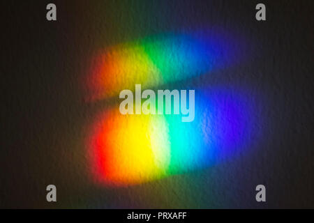 Light refraction on the wall. Spectrum of colors. Light refraction through window glass. Portugal - Stock Photo
