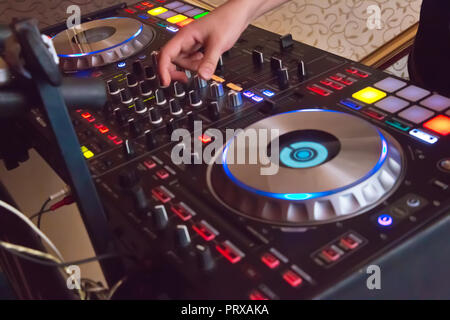 Professional concert dj turntables player device with sound mixer panel and jog wheel.Club disc jockey stage equipment for playing music on party.Digital turn table deck for nightclub - Stock Photo
