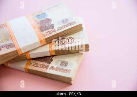 Heap of five thousand russian rubles banknotes.batch of 5000 Russian rubles notes, over pink background.Copy space.Many five thousandth notes. - Stock Photo
