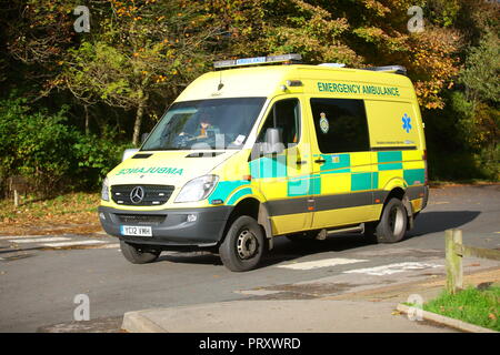 NHS Emergency Ambulance responding to an incident - Stock Photo