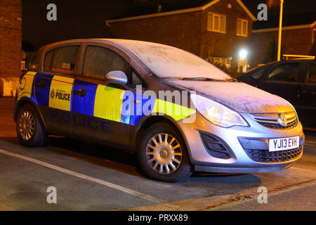 A parked police car covered in frost at Rossington Police Station in Doncaster, South Yorkshire - Stock Photo