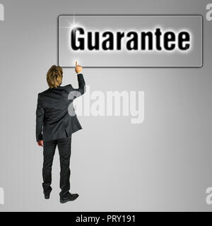 Businessman pressing Guarantee button on virtual interface. - Stock Photo