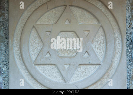 The Star of David engraved in the marble - traditional symbol of modern Jewish identity and Judaism - Stock Photo