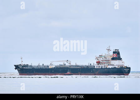 COATZACOALCOS, VER/MEXICO - SEPT 28, 2018: 'Aegean Wave' oil and chemical tanker ship leaves the Pajaritos logistics terminal, aided by a marine pilot - Stock Photo
