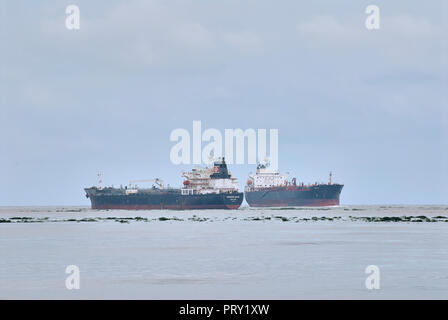 COATZACOALCOS, VER/MEXICO - SEPT 28, 2018: 'Aegean Wave' ship departs and 'Tampico' oil  tanker enters to the Pajaritos logistics terminal - Stock Photo