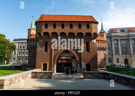 Krakow, Poland - August 23, 2018: Barbican outside of the city walls of Krakow's old town, Poland. - Stock Photo