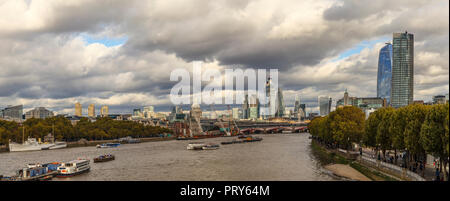 Panoramic view looking east from Waterloo Bridge over the River Thames to the City of London financial district skyscrapers and St Paul's Cathedral - Stock Photo