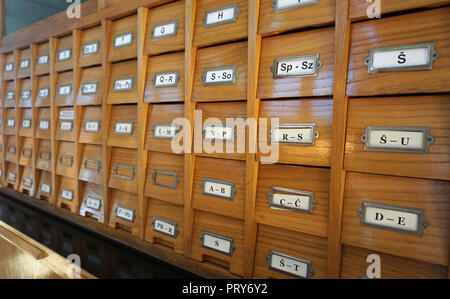 Library old wooden catalog for catalog cards, with letters on drawers, side view - Stock Photo