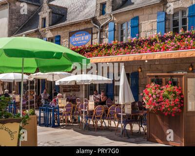 CONCARNEAU French alfresco restaurant 'La Port Au Vin' with floral colour flowers display & diners Ville Close de Concarneau Bretagne Finistere France - Stock Photo