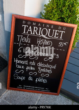 Blackboard French Menu outside upscale restaurant advertising Lobster,Oysters and Fish soup, with Domaine du Tariquet wines  Pont Aven Brittany France - Stock Photo