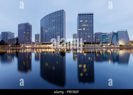 Downtown Oakland and Lake Merritt Reflections at Twilight. - Stock Photo