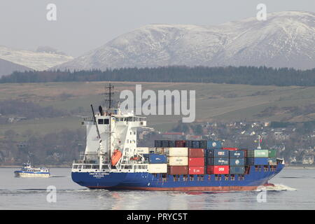 The container ship MS Kristin Schepers heading up the Firth of Clyde, with Argyll Ferries' passenger ferry Ali Cat in the background. - Stock Photo