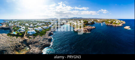 Aerial view, Punta des Jonc and Cala Marcal bay with villas and yachts, Portocolom, Felanix region, Majorca, Balearic Islands - Stock Photo