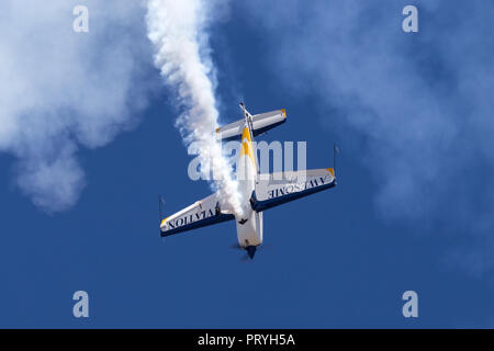 British aerobatic pilot Mark Jefferies flying a single engine Extra 330LX aerobatic aircraft VH-IXN. - Stock Photo
