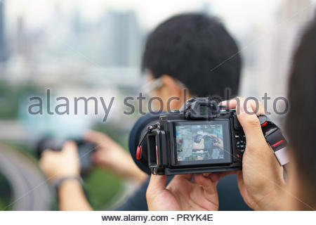 Professional photographer concentrate and continue his passion for photography - Stock Photo