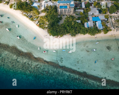 Maldives, Aerial view of beach and boats - Stock Photo
