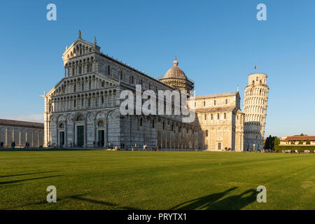 Italy, Tuscany, Pisa, View to Pisa Cathedral and Leaning Tower of Pisa from Piazza dei Miracoli in the evening light - Stock Photo
