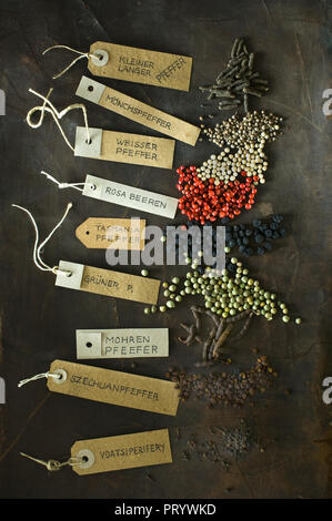 Various sorts of pepper and labelled tags - Stock Photo