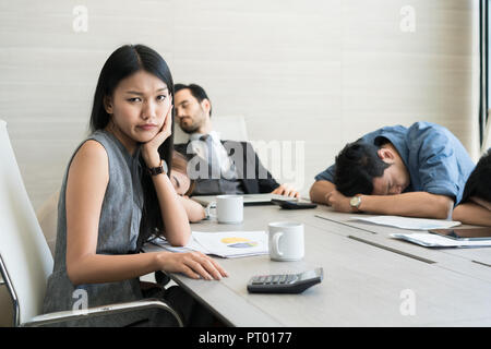 Bored business people and sleeping resting on workplace during work meeting, concept of exhausted businesspeople bored sleep tired. - Stock Photo