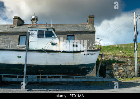 Ireland, Inish Boffin Island, Boat in dry dock waiting to be repaired and painted. - Stock Photo