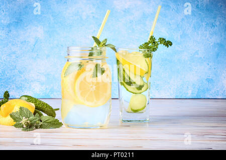 Set of two popular diet detox drinks for cleansing Antioxidant Cucumber Water and Lemonade with Mint Leaves Homemade Food Concept - Stock Photo
