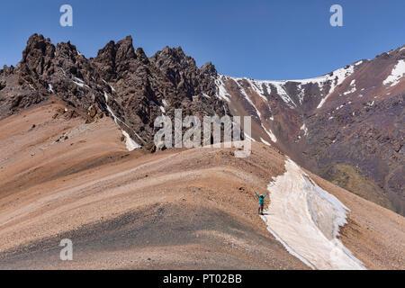 Trekkers celebrate a successful ascent of the 4,750 meter Gumbezkul Pass in the remote Pshart Valley, Gorno-Badakhshan Autonomous Region, Tajikistan. - Stock Photo