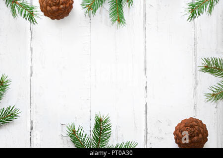 Fir branch on old wooden shabby background with copy space for text. Christmas - Stock Photo