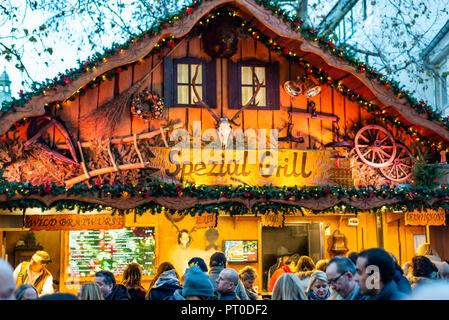 Bonn Germany 17.12.2017 imbiss selling food meat and sausages Traditional Christmas market by night. - Stock Photo