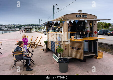 Tin box mobile coffee van company on the sea front, serving fresh specialised coffee to customers - Stock Photo