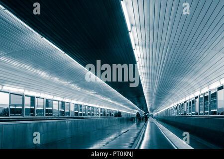 Skywalk bridge linking airport and train station at Barcelona El Prat airport. Spain - Stock Photo