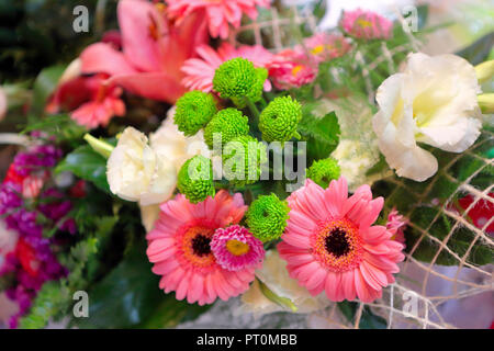 Bouquet of flowers in a basket - Stock Photo