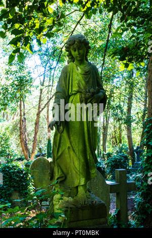 Stone angel in Highgate Cemetery, London - Stock Photo
