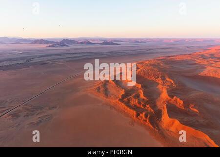 Africa, Namibia, Namib desert, Namib-Naukluft National Park, Aerial view of desert dunes, air balloons - Stock Photo