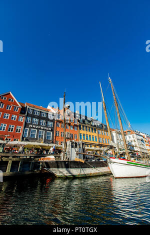 COPENHAGEN, DENMARK - JUNE 13, 2018: Detail from Nyhavn in Copenhagen, Denmark. Nyhavn is a 17th century waterfront and entertainment district in Cope - Stock Photo