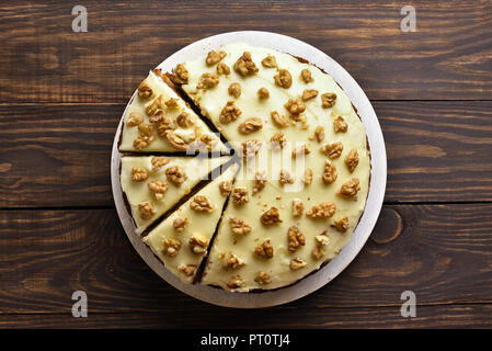 Vegetable fruit carrot cake on wooden background. Healthy homemade baking. Top view, flat lay - Stock Photo