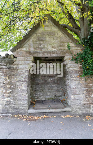 Well restored to commemorate the wedding of H.R.H. Prince Charles and Lady Diana Spencer, Corfe Castle, Dorset - Stock Photo