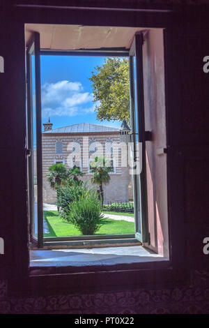 Istanbul, Turkey, September 2018: View through a window of the museum in the second courtyard onto a building in the first courtyard of the Topkapi Pa