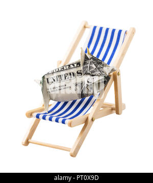 Moneybox in form of pig made of dollar, lying on chaise lounge, isolated on white background - Stock Photo