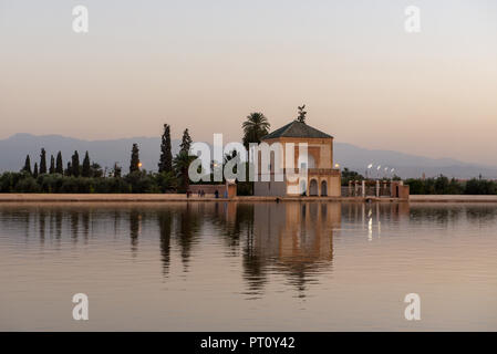 The Menara gardens are botanical gardens located to the west of Marrakech, Morocco, near the Atlas Mountains. - Stock Photo