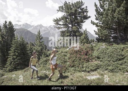 young woman hiking in moutains (model released) - Stock Photo