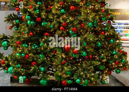 Decorated Christmas tree during Christmas celebrations, at Oslo airport, Norway. - Stock Photo