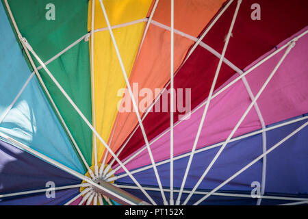 Rainbow colored umbrella, showing the inside of the parasol. Useful for background texture image - Stock Photo