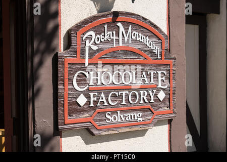 SOLVANG, CA: Sign for the Rocky Mountain Chocolate Factory, a dessert shop in the California Danish Village of Solvang, a town in Central California i - Stock Photo