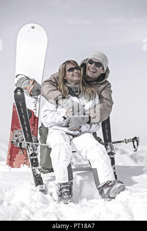 young couple having fun at winter holiday (model-released) - Stock Photo